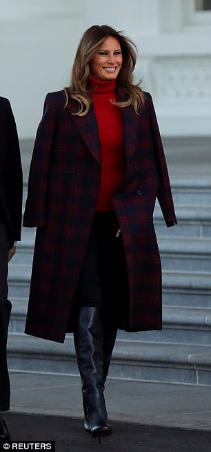 The First Lady covered her shoulders with $1,600 Calvin Klein plaid coat to greet the official White House Christmas tree last November
