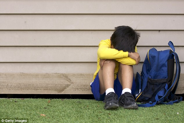 Experts have reveal five ways you can help your child if they are being bullied. They say you should never tell your child to hit back, and always report the issue (stock image)